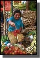 Picture of lady in fruit market Bali Indonesia