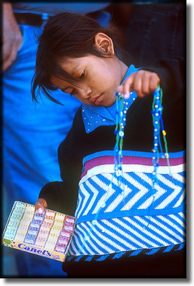 Photograph of, Ensenada Mexico, street vendor, child selling chicklets