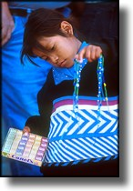 Photograph of child selling chicklets